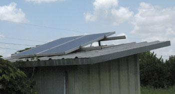 Solar panels mounted on roof of pump house