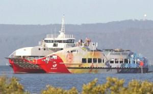 Big Red Cat enteringToondah Harbour