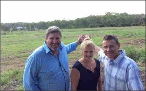Steve Davis, Karen Williamd and Andrew Laming hamming it up on the Commonwealth lands in Birkdale.