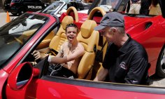 Thomas Sutton, Jr., 13, from Enid, is thrilled to sit in the driver's seat of David Geffre's 360 Ferrari sports car. Redline4Kids is a new nonprofit that helps connect kids in the hospital with a chance to see cool cars. Photo by Jim Beckel, The Oklahoman