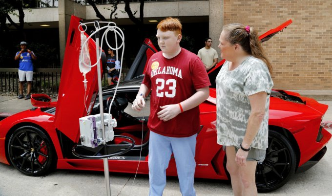 A patient leaves this sports car and walks to another one, just a few feet away. Redline4Kids is a new nonprofit that helps connect kids in the hospital with a chance to see cool cars. Photo by Jim Beckel, The Oklahoman