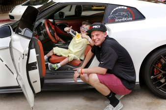 The opportunity to sit inside this sports car owned by Chance Wynn, right, brought a smile to the face of Children's Hospital patient, Jonathan Kidd, 6, from Bethel Acres. Redline4Kids is a new nonprofit that helps connect kids in the hospital with a chance to see cool cars. Photo by Jim Beckel, The Oklahoman