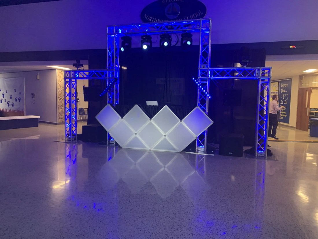 truss arch with lighting fx over dj