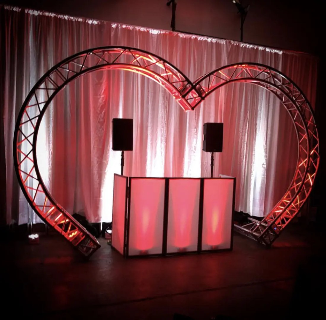 white pipe and drape with heart truss in front
