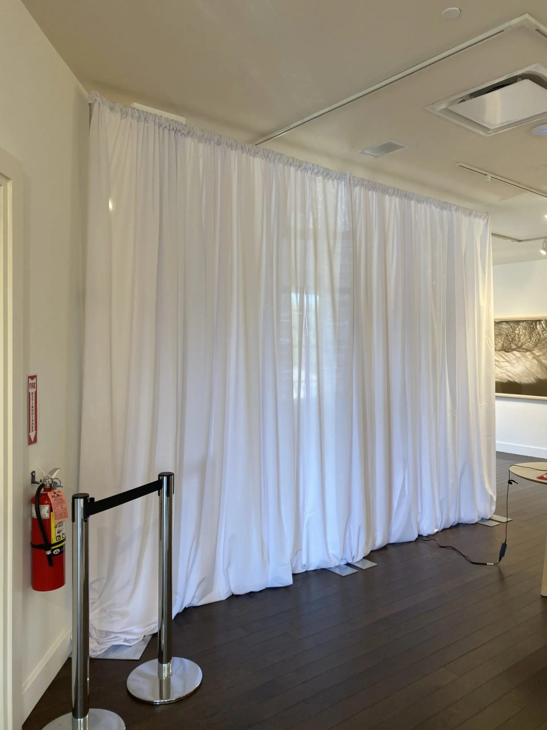 pipe and drape in museum for room divider