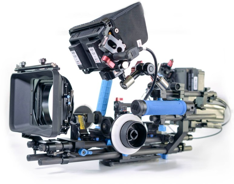 """The base of 'Ruby' is built on two pair of RedRock 18"""" carbon fibre rods stacked to separate the optical and stabilisation attachments. The top rods feature the camera's baseplate, lens support, Focus / zoom wheels, and a light weight matt box that can host two 4x4"""" filter trays. The lower rods hold the side frame, handles, and universal Zacuto arms for mounting screens and recorders. A universal cheese plate also features on the lower rods for mounting to tripods or shoulder mounts."""