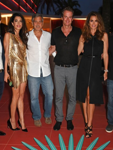 IBIZA, SPAIN - AUGUST 23: Amal Clooney, Co-Founders of Casamigos Tequila George Clooney and Rande Gerber and Cindy Crawford attend as Casamigos founders Rande Gerber, George Clooney and Mike Meldman host the official launch of Casamigos Tequila in Ibiza and Spain at Ushuaia Ibiza Beach Hotel on August 23, 2015 in Ibiza, Spain. (Photo by David M. Benett/Dave Benett/Getty Images for Casamigos Tequila)