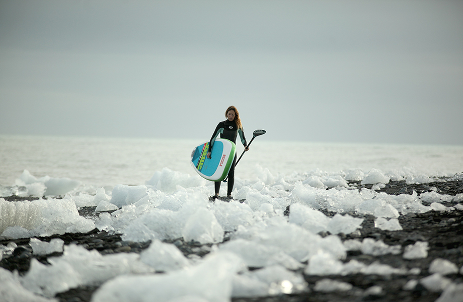 Nuria Goma wearing winter clothing on our 810 Whip inflatable paddle board