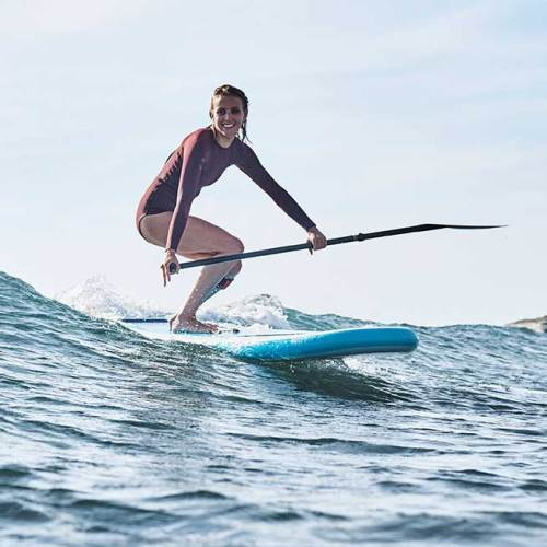 """Woman surfing her Red Paddle Co 8'10"""" Whip"""