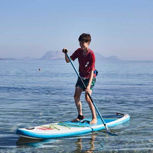 """boy paddling the Red Paddle Co 9'4"""" Snapper"""