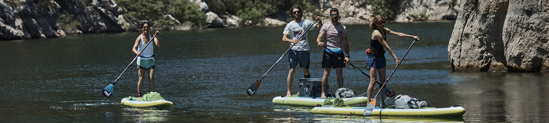group of paddle boarders exploring the river