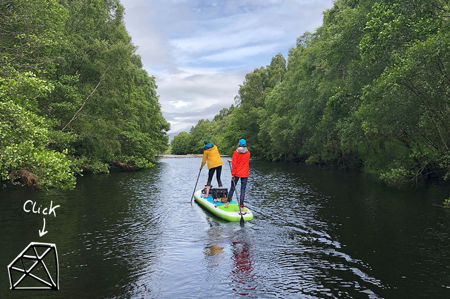 two paddlers on Tandem inflatable SUP in middle of river