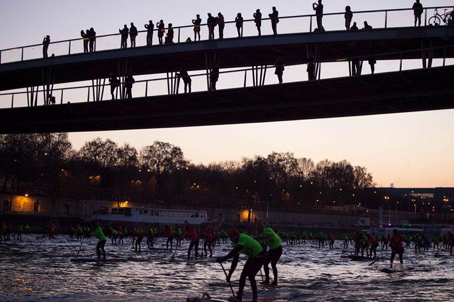Silhouette of spectators watching Nautic SUP Open in Paris
