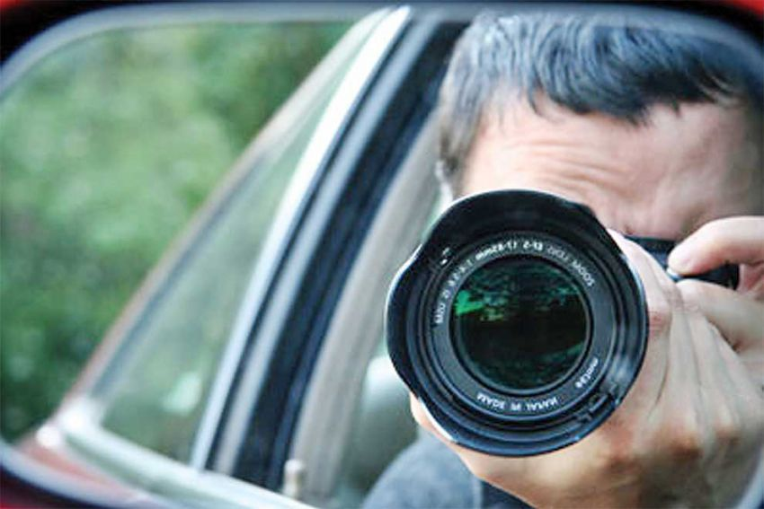 a-representative-image-of-a-private-investigator-photographing-his-subject-from-a-car.-supplied.jpg