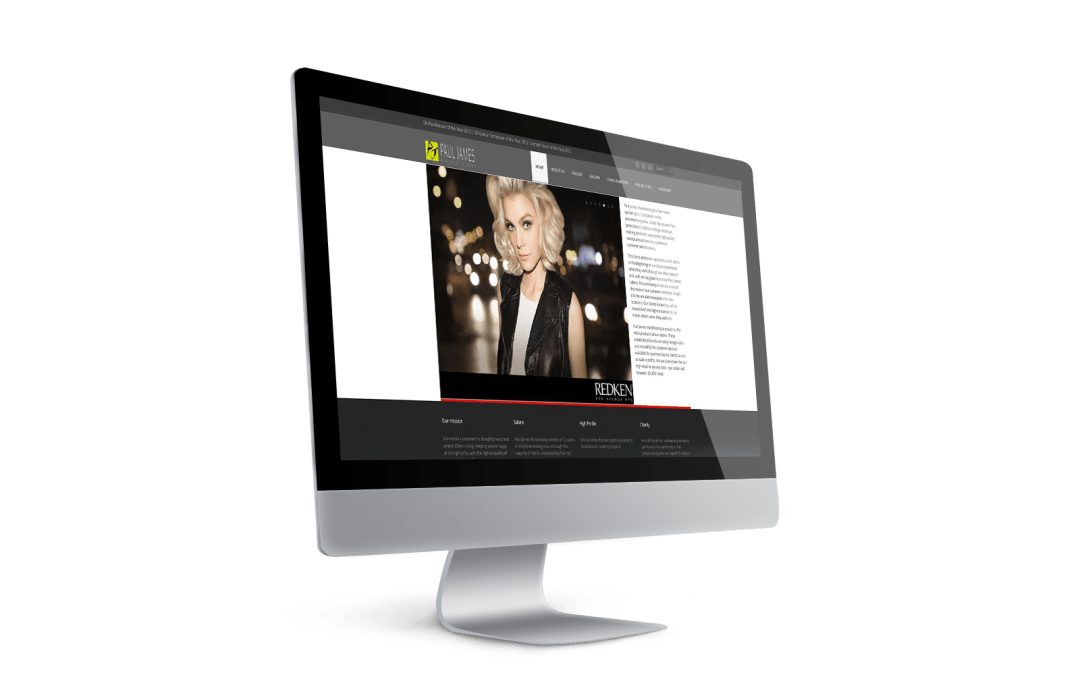 Paul James Hairdressing home page displayed on a screen