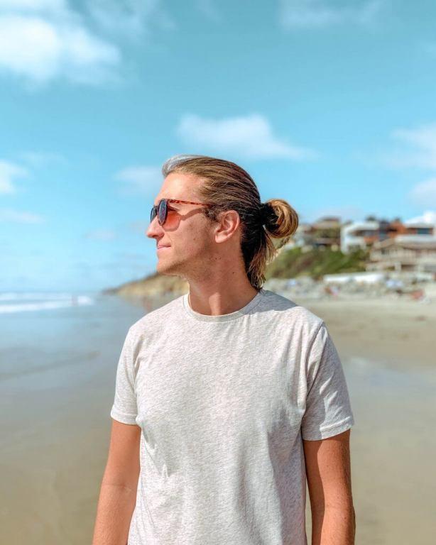 Dom walking at a beach in San Diego, California.