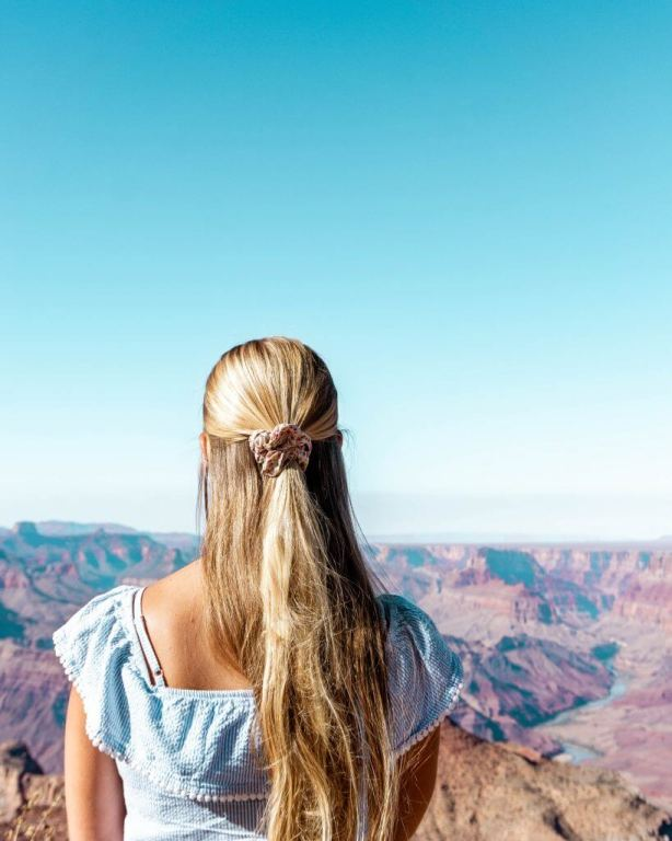 Jo standing in front of the Grand Canyon.