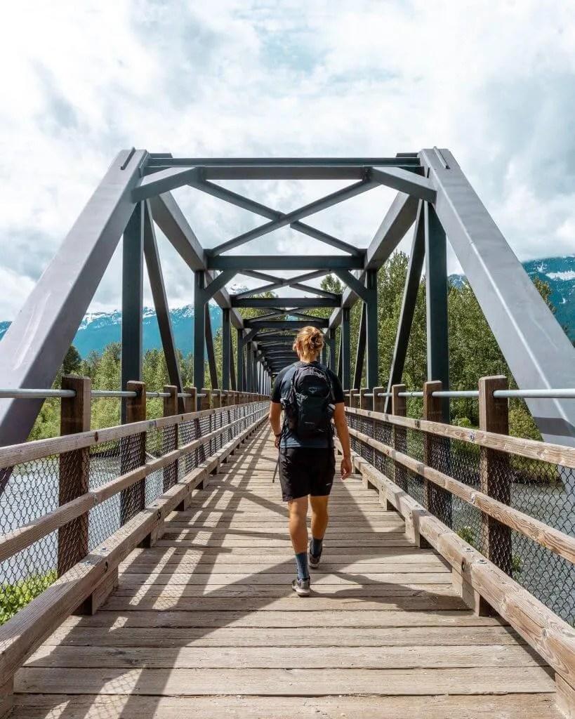 Dom walking on a bridge in Revelstoke.