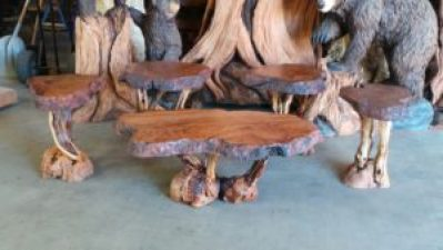 Redwood furniture - a redwood burl coffee table and four end tables finished in tung oil