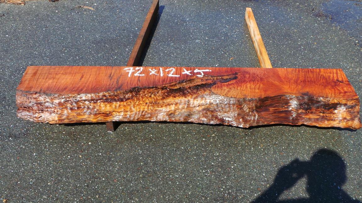 Figured redwood mantel