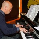 Photo of Paul Hamilton playing piano