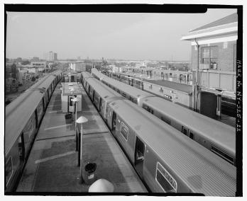 View of platforms and trains from RTO building elevated platform looking north. Stillwell Avenue Station, Intersection of Stillwell and Surf Avenues, Brooklyn, New York (source: http://1.usa.gov/1dR4a1V)