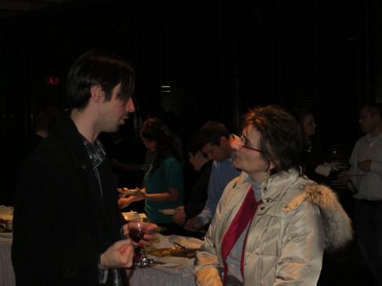 Thornton Miller having a conversation at the REEEC Winter Reception