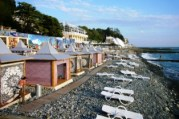 Sochi benefits from a mild climate and its rock beaches gave vacationers a place to take in the sun. In earlier days, sunbathing would have been considered a medical procedure and was supervised by medical personnel. Photo by Diane Koenker.