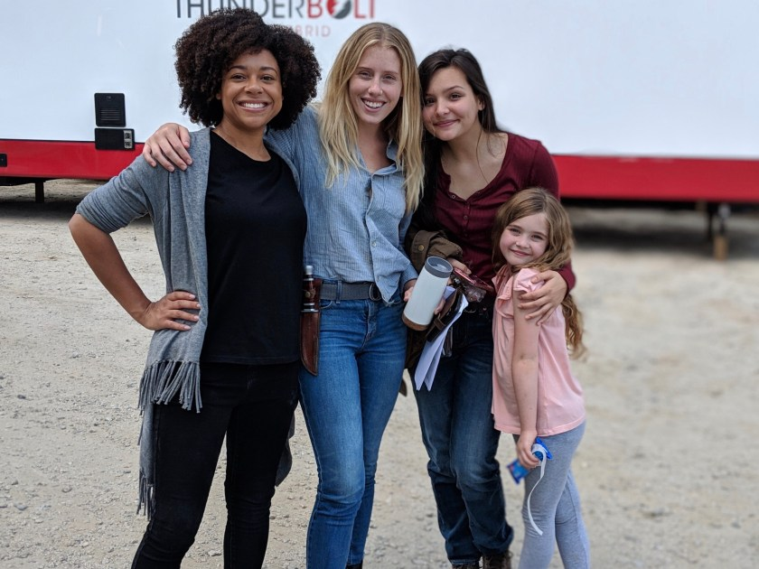 Photo of Tamara Austin with 3 other cast in full costume behind the scenes of The Walking Dead
