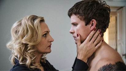 Image shows Christian (Adam Pålsson) with Lena (Maria Sundbom Lörelius) who holds his face in her hands