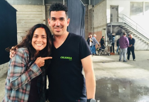 Image shows Abraham Martínez standing right with Alice Braga (Teresa Mendoza) standing left. He has his arm around her shoulders while she points to him with the index finger of her right hand.