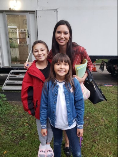 Image shows Sera-Lys McArthur (centre) behind the scenes of Burden of Truth S3. Either side of her stand her on screen daughters, Brooklyn Letexier-Hart and Olivia Sinclair.