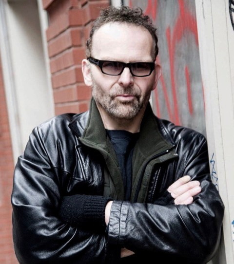 Photo shows Alex Ziwak in leather jacket, arms crossed and sunglasses.