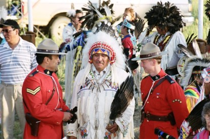 Dan Bradford (left) in full RCMP uniform at an Indigenous gathering