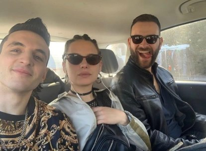 Behind the scenes photo of Suburra: Blood on Rome. Inside a car or shows Alessandro Borghi (right) with sunglasses and his tongue out. Federika Sabatini (centre) with sunglasses and earphones. Giacomo Ferrara (left)