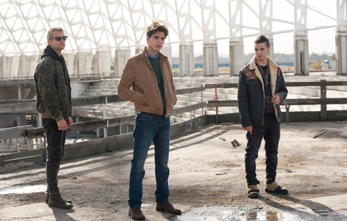 From season 1 of Suburra: Blood on Rome set in an abandoned incomplete shell of a large building. The three characters of Aureliano (left) Lele (centre) and Spadino (right)