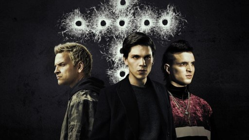 Poster for season 1 of Suburra: Blood on Rome with Spadino right, Lele centre and Aureliano left. Behind them are a pattern of bullet holes in glass in the shape of a cross
