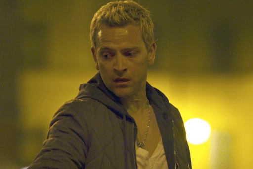 Aureliano Adami (Alessandro Borghi) in a scene from season 1 of Suburra: Blood on Rome. Strongly yellow colour palette to this shot.