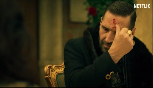Yellow colour palette image of Manfredi marking his forehead with blood