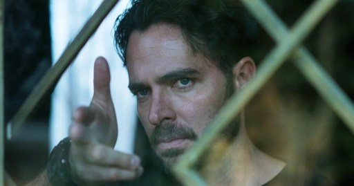 Álex (Manolo Cardona) points his fingers in a pistol gesture in Who Killed Sara?