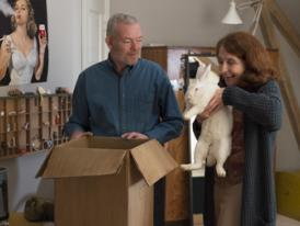 Søren Malling and Bodil Jørgensen with a white rabbit in a scene from Parents