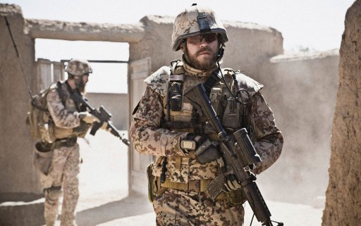 Pilou Asbæk (foreground) as Claus M. Pedersen with Christian 'Krolle' Pedersen (rear) as 'Slagter/Butcher' Jensen in a scene from A War