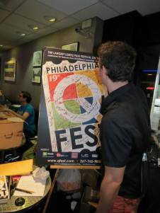 Signing the QFest Poster