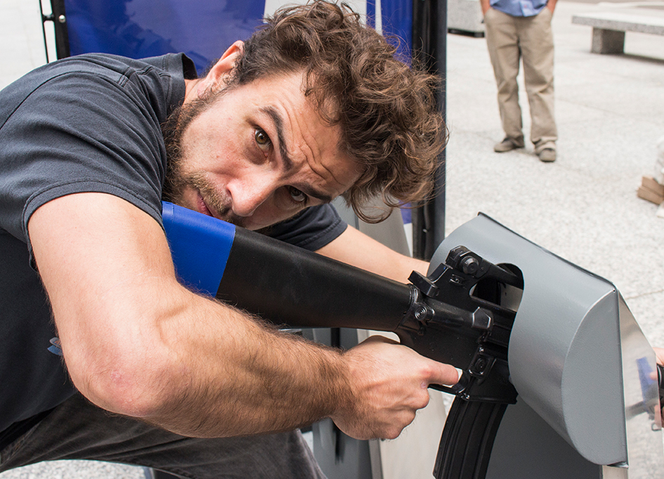 Ojo Customs' Kevin O'Neill interacts with the Metro Gun Share installation in Daley Plaza