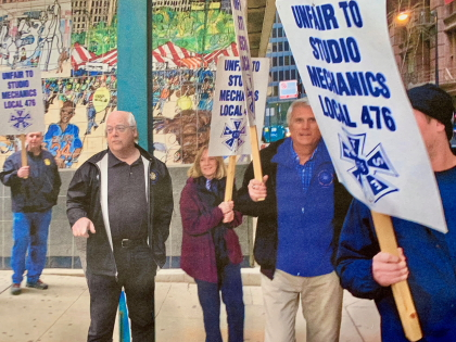 Local 476 Business Agent Mark Hogan (second from left) leading the picket line in Chicago