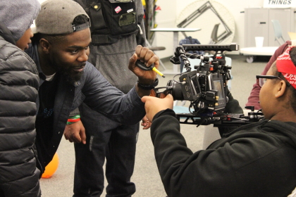 'Chicago Fire' crew member J'mme Love teaches kids about film gear during an OCIY session