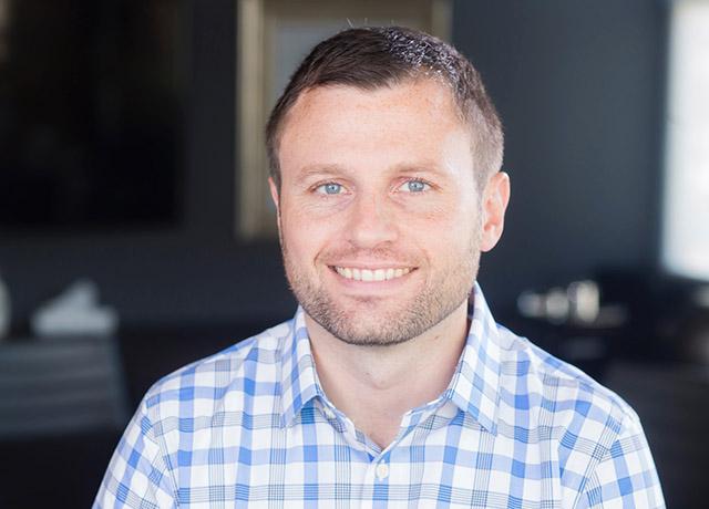 One at Optimus signs Director George Zwierzynski Jr.