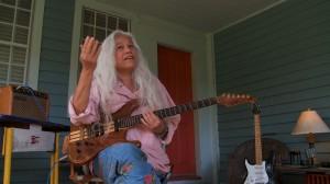 Rock n Roller June Millington rehearsing