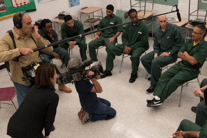 Documentary Film team filming BPI students sitting in a semi-circle