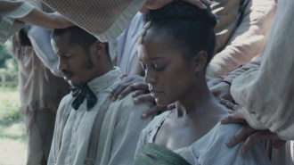 """Nate Parker as """"Nat Turner"""" and Aja Naomi King as """"Cherry"""" in THE BIRTH OF A NATION. Photo courtesy of Fox Searchlight Pictures. © 2016 Twentieth Century Fox Film Corporation All Rights Reserved"""